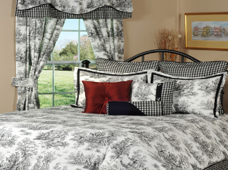 This is a traditional toile featuring a French countryside setting in black on white.