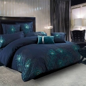 This beautiful duvet cover set features a bold and sophisticated fashion statement with climbing peacock feathers that embellish the duvet cover and shams.